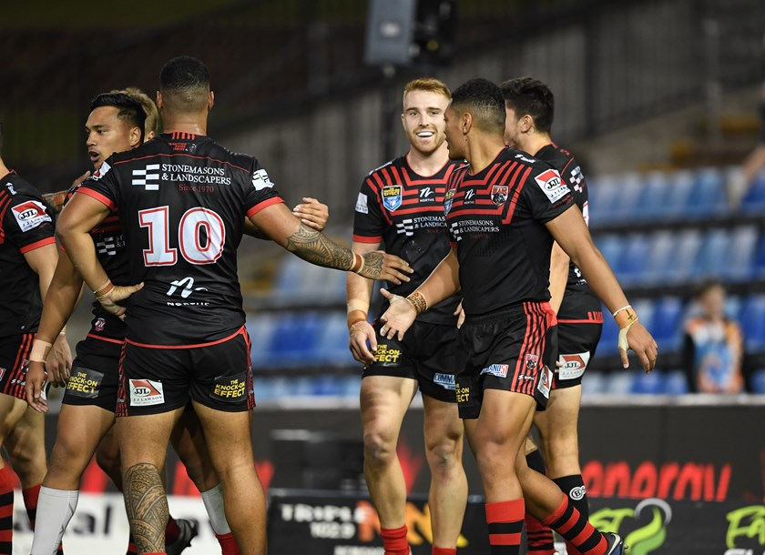 Solid Victory: The North Sydney Bears congratulate one another on a job well done.