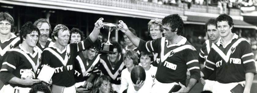 Arthur Beetson and fellow Immortal Bob Fulton hold the Wills Cup after the Roosters win in the 1977 pre-season final.