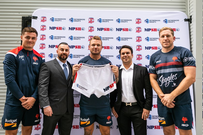 Kyle Flanagan, Mohamed Kabbout (Skyworkers Group CEO), Captain Jake Friend, John Karavasilias (MPSR GM) and Mitchell Aubusson launch the 2020 Sydney Roosters shorts.