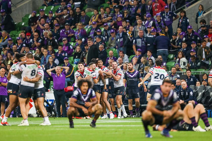 The Roosters crowd Latrell Mitchell after he kicks the game winning field goal against the Melbourne Storm.