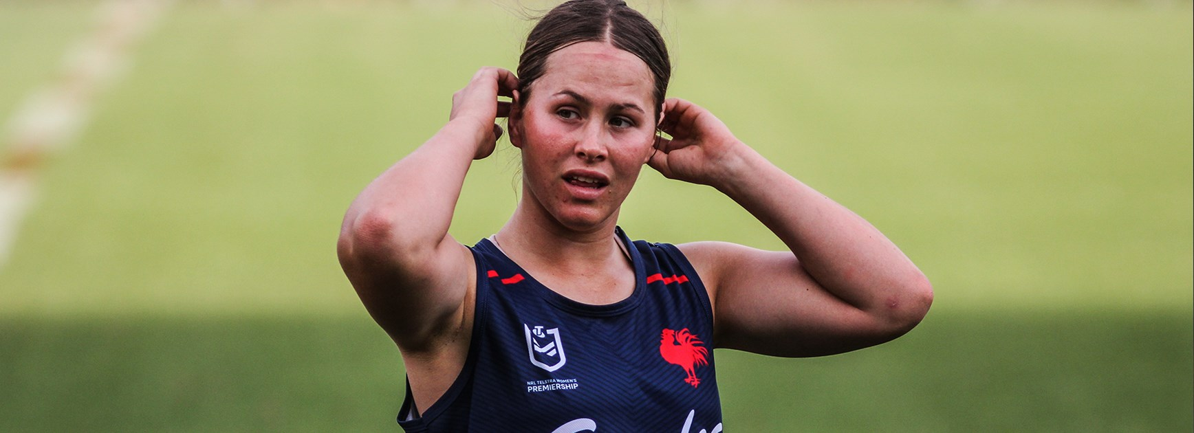 Keilee Joseph lighting the Roosters pathway to NRLW