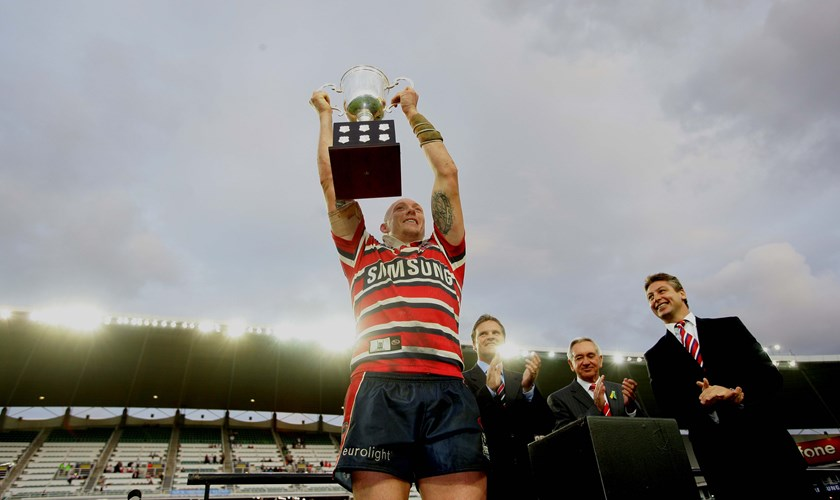 Captain Craig Fitzgibbon holds up the Anzac Cup in 2007.