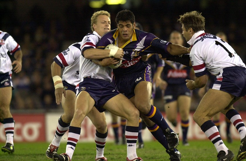 Steve Kearney gets tackled by Ryan Cross and Luke Ricketson in 2001.