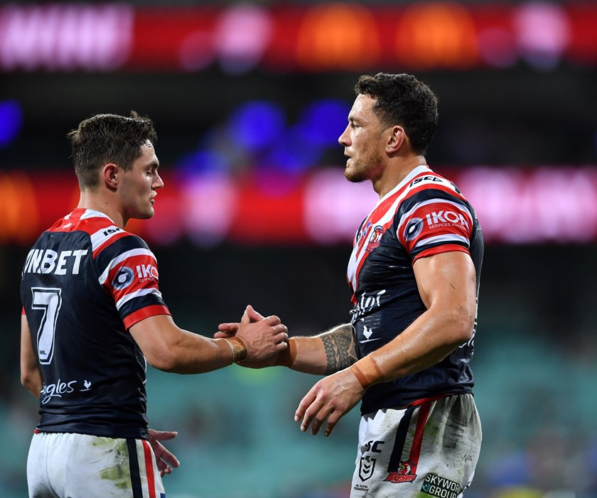 Sonny Bill Williams celebrates a victory with Kyle Flanagan.